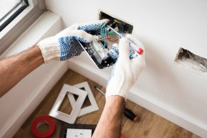 a man performing electrical repairs at home