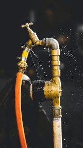 A leaking garden water pipe