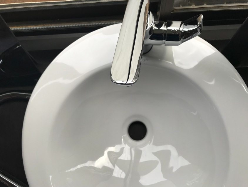 white sink with steel faucet