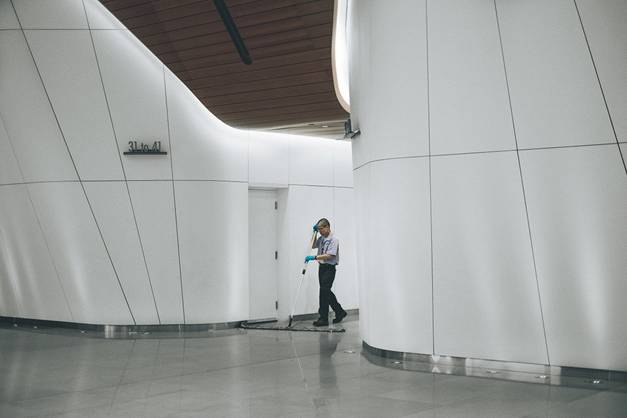 A janitor cleaning the corridors of the office