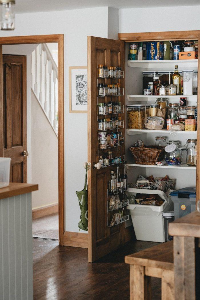 hidden pantry designed using recessed shelves