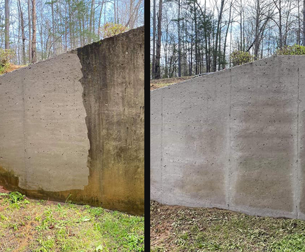 A concrete wall pressure washed.