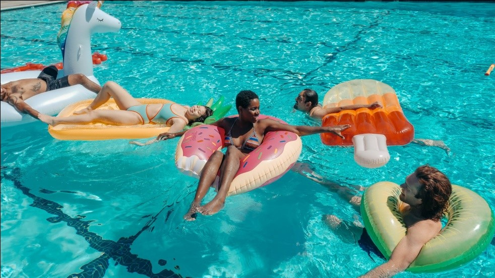 People on floats in a pool