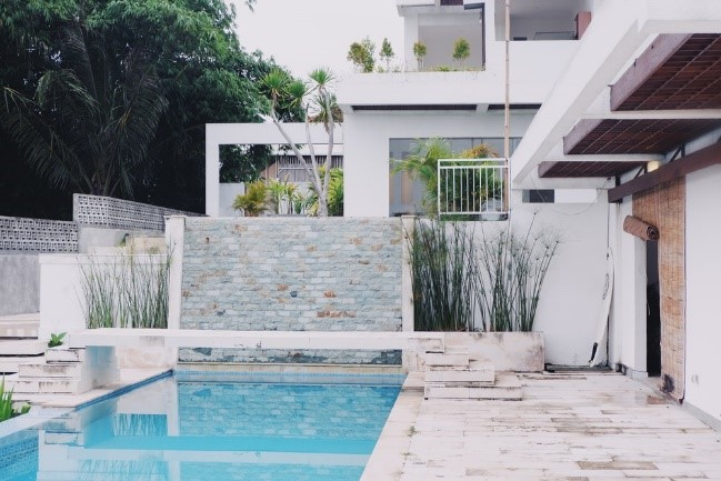 A small swimming pool built in the backyard of compact residential property