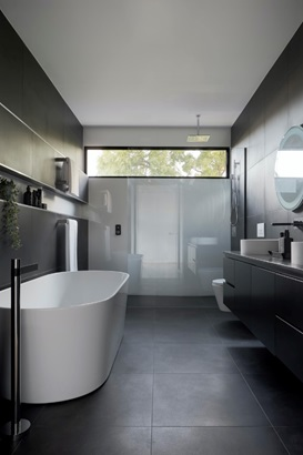 A modern bathroom with a floating vanity.
