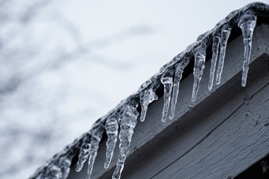 ice on the roof of a house